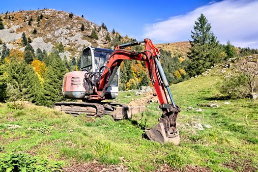 An image of a digger in the mountains