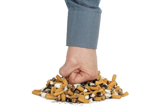 fist is punching heap of cigarettes