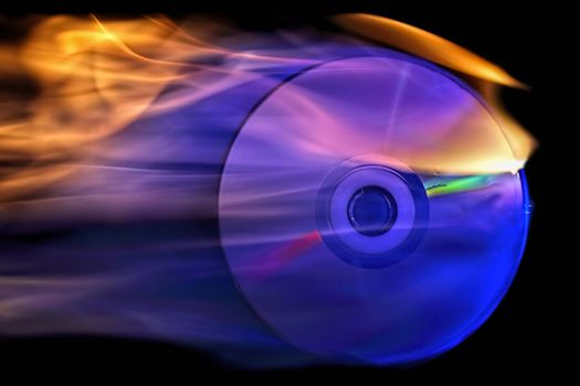 cd is on fire against black background