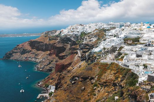 Panoramic view  of Oia ,  a small village on the edge of the caldera, by day, Santorini, Greece