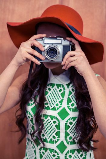 Woman taking photograph with camera