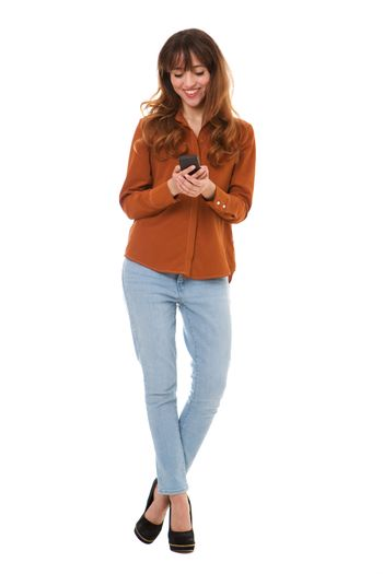 Full body happy young woman looking at cellphone