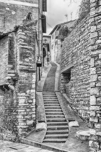 Walking in the picturesque and ancient streets of Assisi, one of the most beautiful medieval towns in central Italy