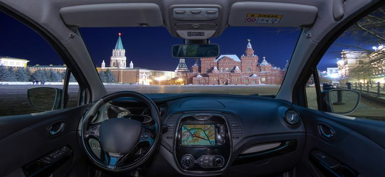 Looking through a car windshield with view of Red Square at night, Moscow, Russia