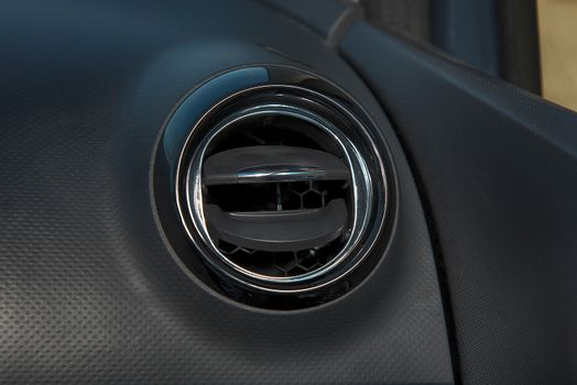 Interior of a car with closeup of  ventilation grille for air conditioning
