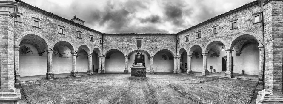 Panoramic view of the ancient cloister inside the Basilica of Saint Ubaldo, a roman catholic church atop Mount Ingino, outside central Gubbio in Umbria, Italy