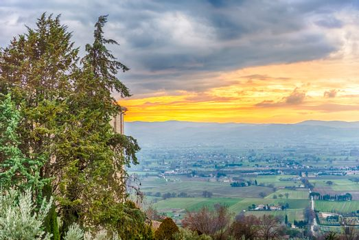 Scenic sunset as seen from Assisi, on the western flank of Monte Subasio, Italy