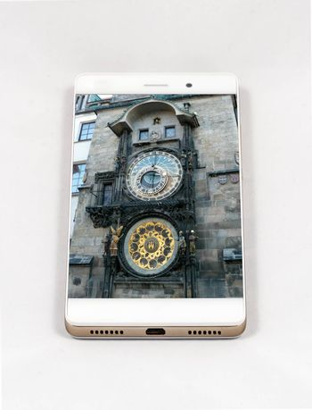 Modern smartphone with full screen picture of the iconic Prague Astronomical Clock, Czech Republic. Concept for travel smartphone photography. All images in this composition are made by me and separately available on my portfolio