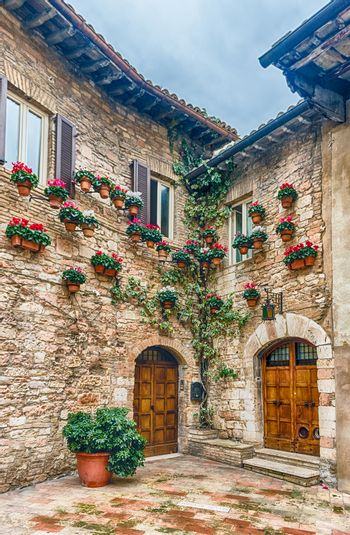 Historical buildings in the old city center of Assisi, one of the most beautiful medieval towns in central Italy