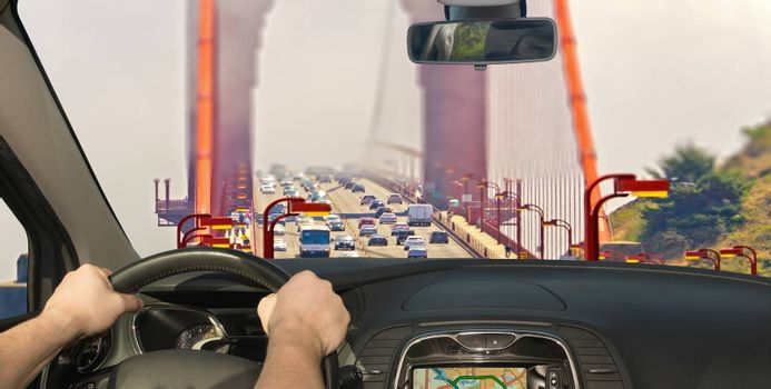 Driving a car towards the traffic on the Golden Gate Bridge in San Francisco, USA