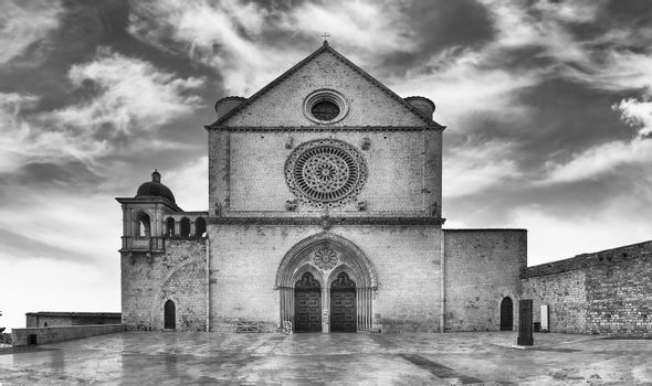Facade of the Papal Basilica of Saint Francis of Assisi, one of the most important places of Christian pilgrimage in Italy. UNESCO World Heritage Site since 2000