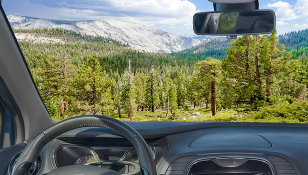 Looking through a car windshield with view of Yosemite National Park, California, USA