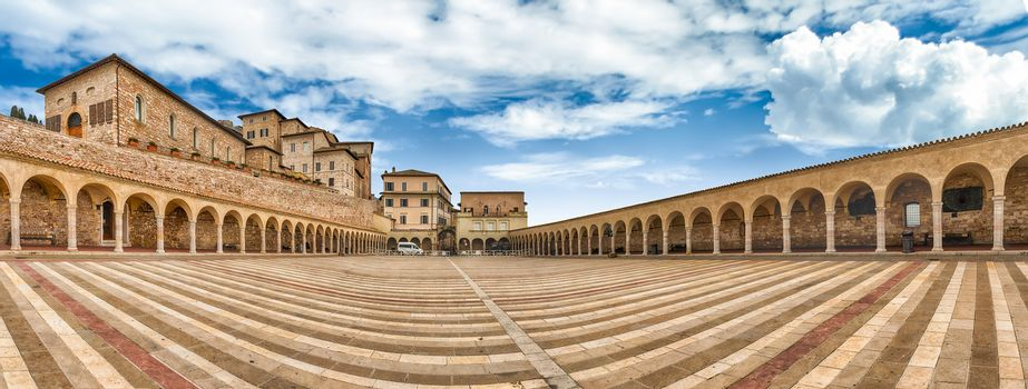 Panoramic view of the historic lower plaza of the Basilica of Saint Francis, Assisi, one of the most important places of Christian pilgrimage in Italy