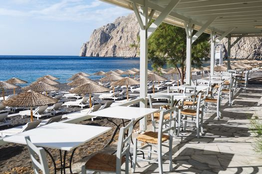 Famous Kamari  black sand beach, view from the walkway. Santorini island, greece