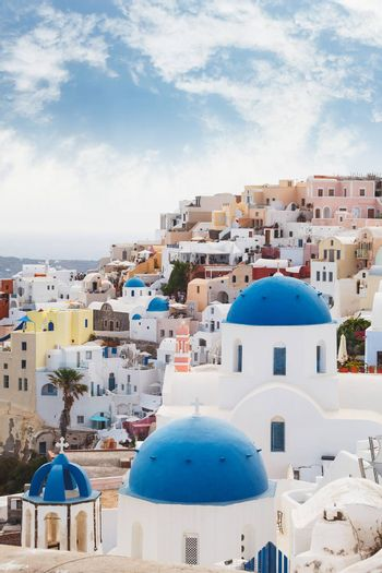 Greek orthodox church with blue domes in the village of Oia, Santorini, Greece