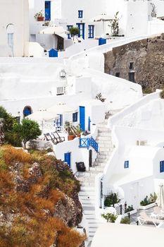 Cycladic houses and stairs, Oia, Santorini Island, Greecee