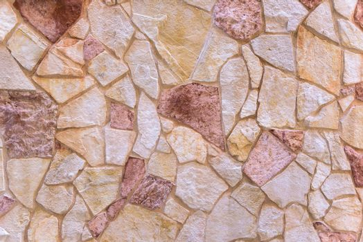 Background or texture made of red stone wall