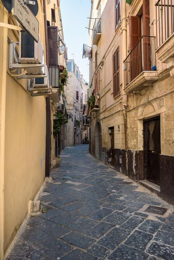 Characteristic narrow street in the old town of Bari, Apulia, Italy