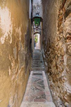 Famous Vicolo Stretto - narrowest street in Taormina, Sicily, Italy