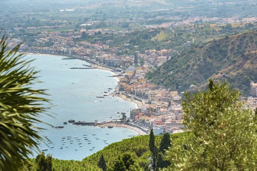 View of Giardini Naxos town from Taormina, Sicily, Italy