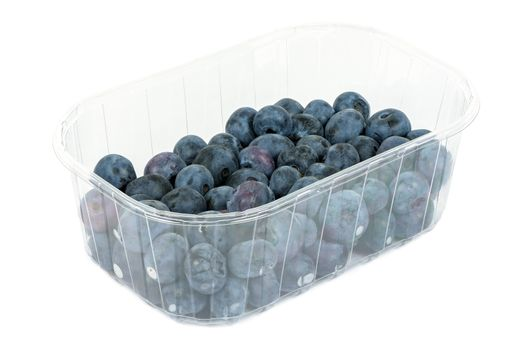 Blueberries in a plastic container isolated on white background with clipping path