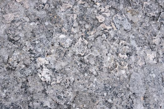 Detailed grey rocky texture as natural background