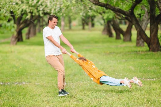Family of dad and daughter having fun outdoors in the park
