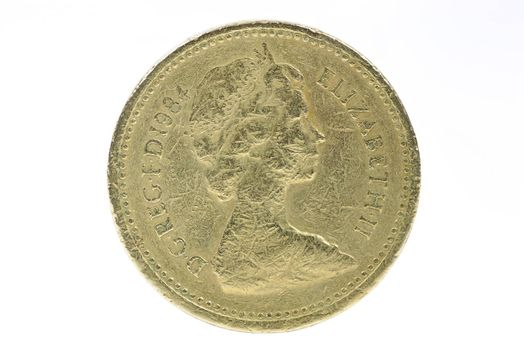 Closeup of british 1 pound coin isolated on white background with clipping path