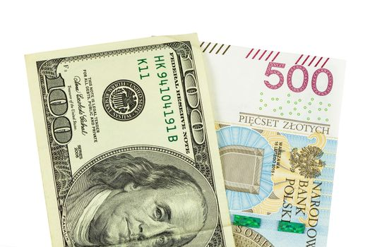 Banknotes of 100 USD and 500 PLN isolated on white background with clipping path