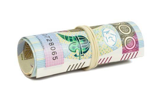 Polish banknotes of 500 PLN rolled with rubber isolated on white background with clipping path
