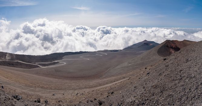 Lunar landscape of the Mount Etna with road on the lava field , Sicily, Italy