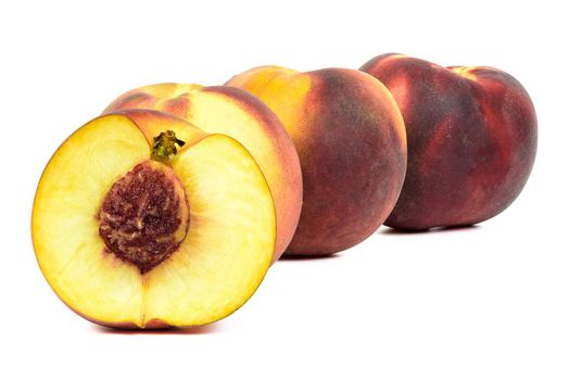 Ripe peaches in a row isolated on white background with clipping path
