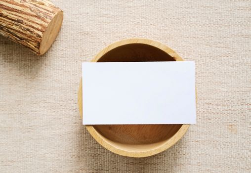 Flat lay of branding identity business name card on wooden container with fabric background, minimal concept for design