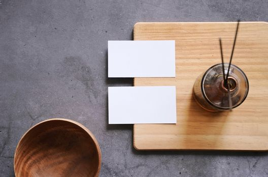 Flat lay branding identity of spa and healthcare business items with blank name card on wooden board, template for design