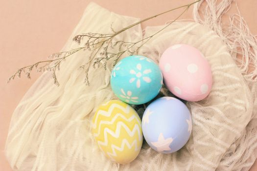 Pastel and colorful easter eggs on cloth with copy space, happy easter holiday concept