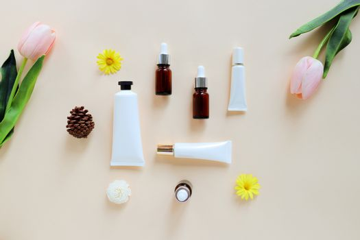Flat lay of various organic skincare and beauty products for mock up with flower in minimal style