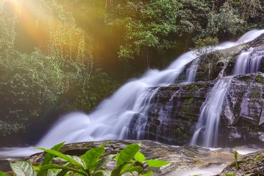 Beautiful landscape of waterfall with light in Chiangmai, Thailand