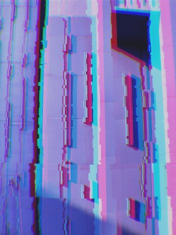 Abstract of modern buildings in the city background with digital glitch effect