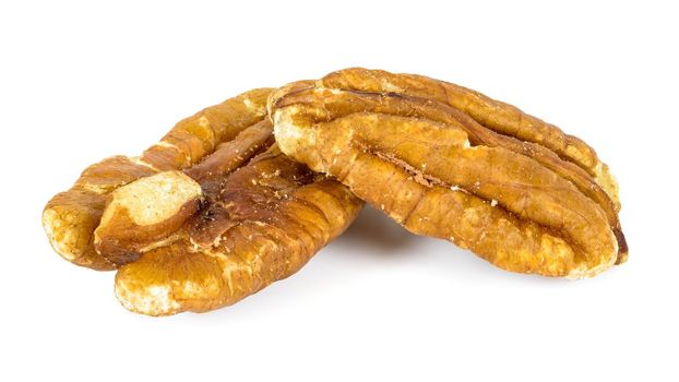 Close-up of pecan nuts isolated on white background with clipping path
