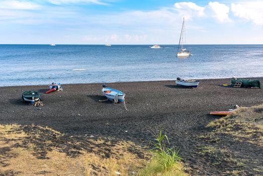 Boats on the black volcanic beach on Stromboli Island