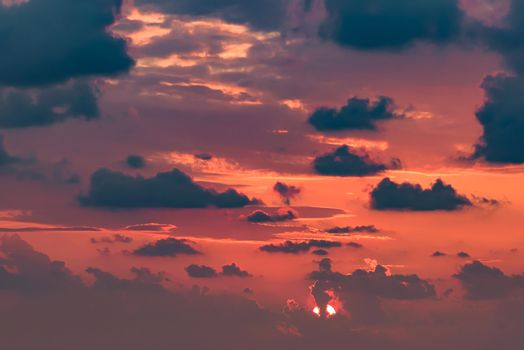 Clouds on the red sky during sunset