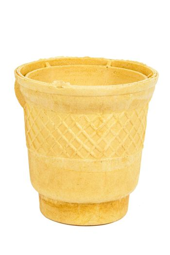 Empty waffle ice cream cup isolated on white background with clipping path