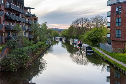 Narrowboats moored at the Grand Union Canal in West Drayton, London, UK