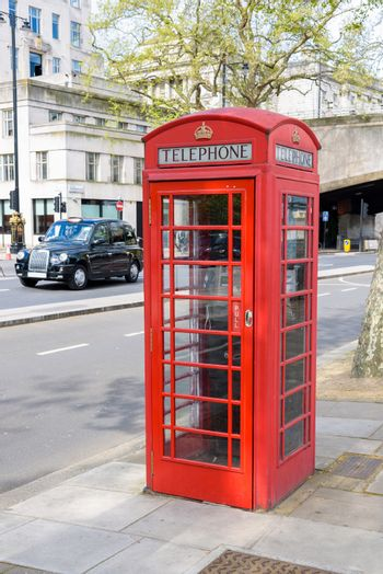 Traditional british red telephone booth in London, UK