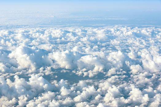 Natural background made of clouds seen from the plane window