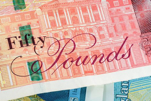 Closeup of 50 pounds banknote. Financial background