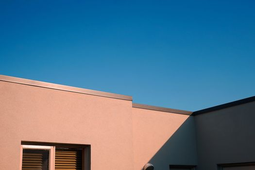 Modern and minimal residential building with light and shadow, summer background
