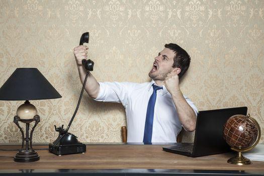 Businessman talking on the phone obnoxious customer