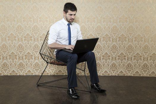 surprised businessman using a laptop