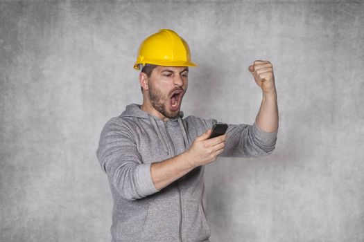 worker shouting into the phone